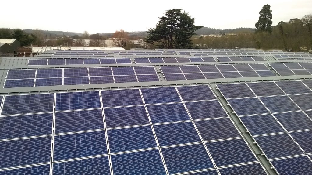 Adding solar PV units to our production roofs